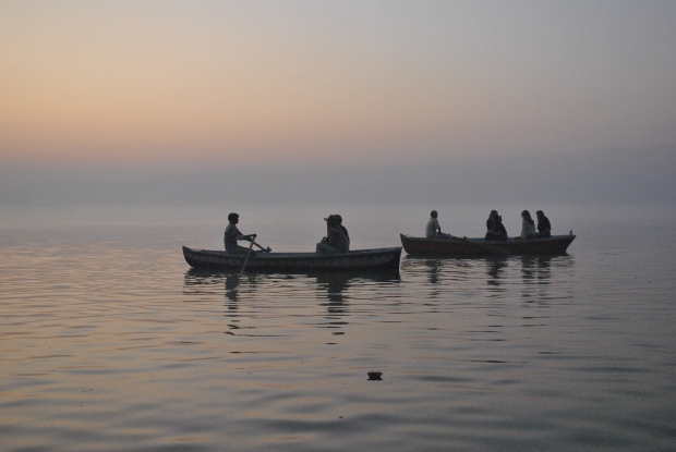 Rowing boats on the Ganges in Varanasi at sunrise