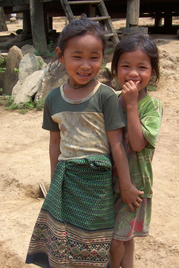 Kids  in a local pristine village in Laos at the banks of Mekong river
