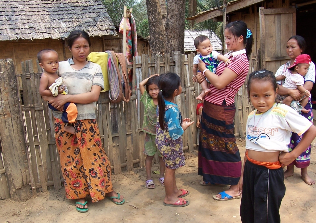 Community in a local pristine village in Laos at the banks of Mekong river