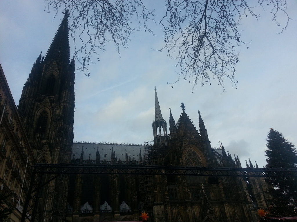 """Christmas market in front at the Roncalli place right next to the """"Kölner Dom"""", the Cologne Cathedral"""