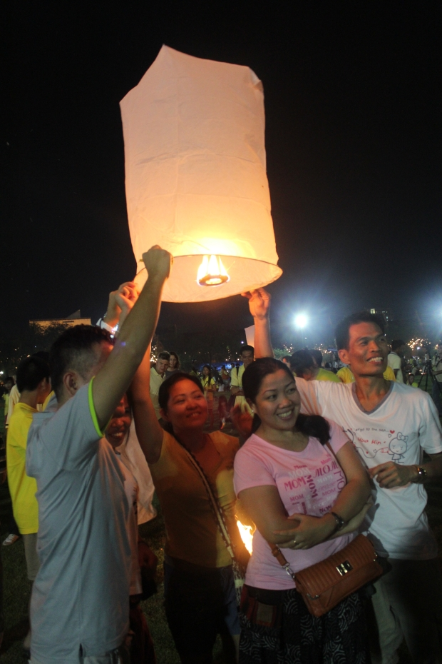 Locals let huge lanterns fly